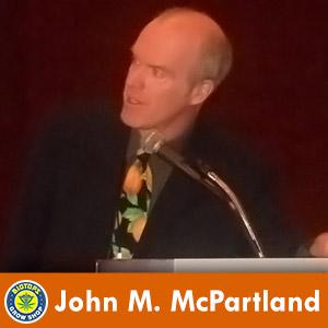 john mcpartland en photo conférence